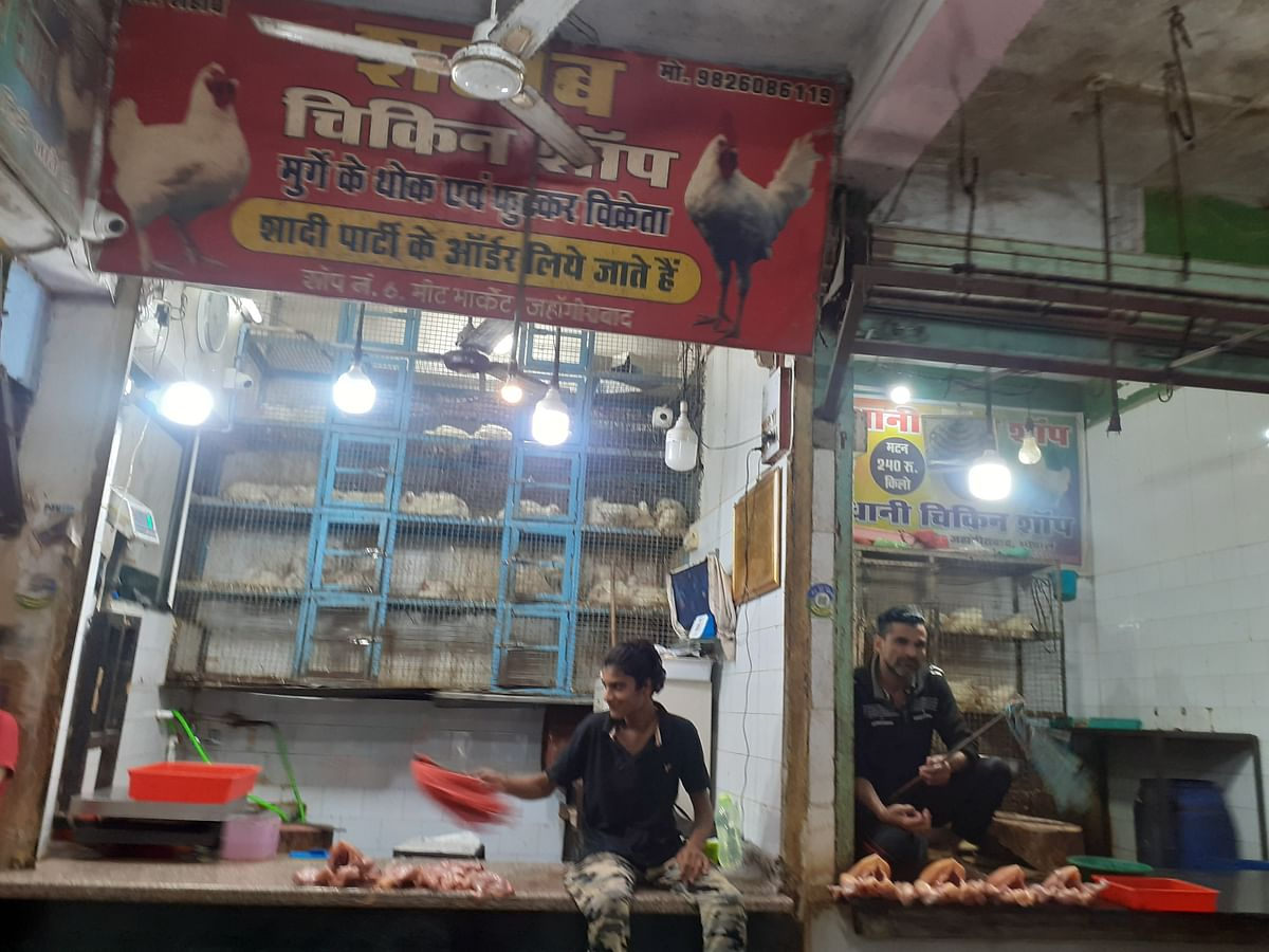 Chicken  sellers waiting for customers in the Meat Market, Jehangirabad  on Thursday.