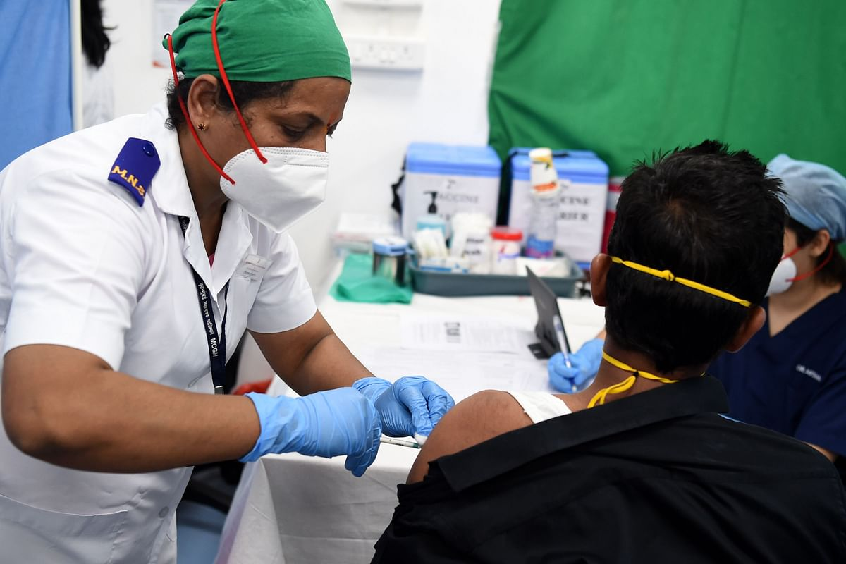 A medical worker inoculates a colleague with a Covid-19 coronavirus vaccine at the Cooper Hospital in Mumbai on January 16, 2021.