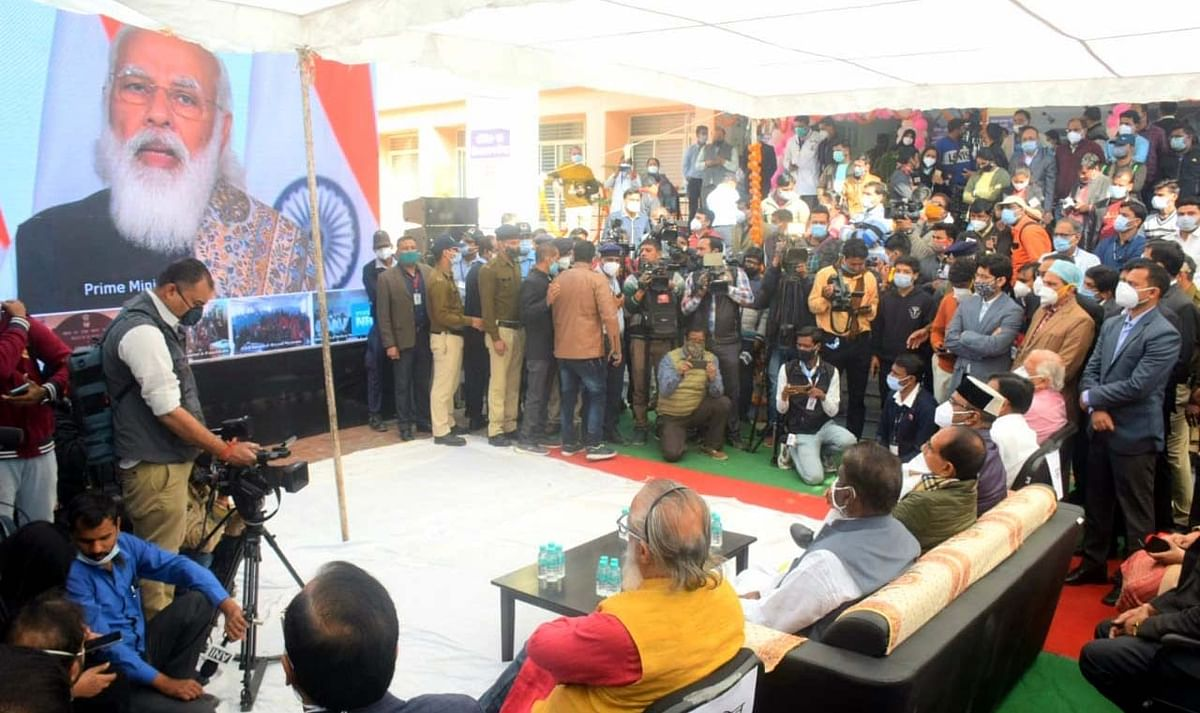 Chief Minister Shivraj Singh Chouhan, health minister Dr Prabhuram Chaudhary and minister for medical education Vishwas Sarang watch PM Narendra Modi's address during the vaccine launch at GMC on Saturday.