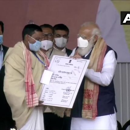 PM Modi distributes land allotment certificates to indigenous people in Assam's Sivasagar