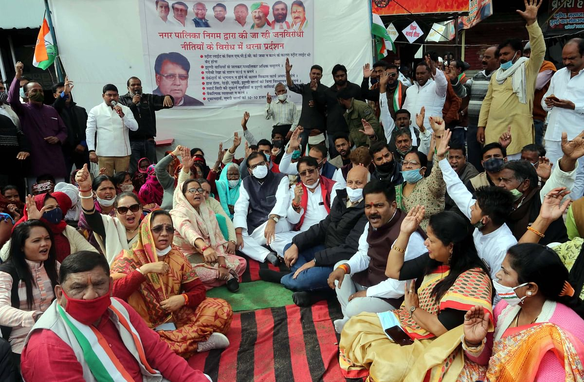 Congressmen led by Former minister and MLA PC Sharma stages sit-in in front of BMC headquarter in Bhopal on Tuesday.