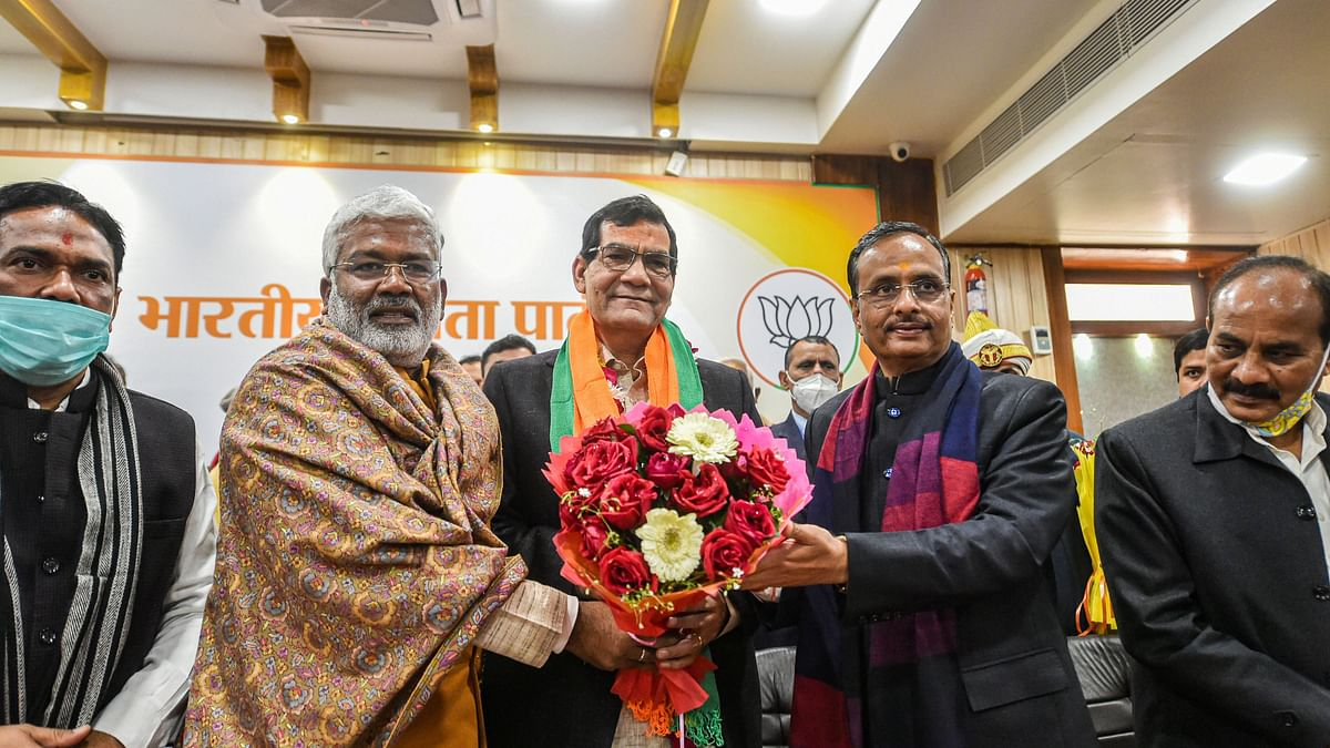Former IAS officer Arvind Kumar Sharma being greeted by UP BJP President Swatantra Dav Singh and Deputy CM Dinesh Sharma as he joins the party, in Lucknow, Thursday, Jan. 14, 202