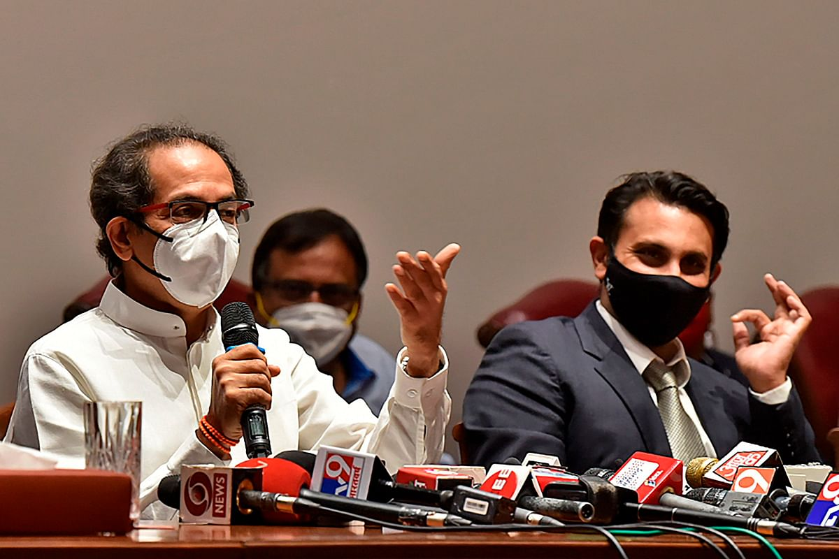 Uddhav Thackeray (L), the chief minister of Maharashtra state, speaks as the Serum Institute of Indias CEO Adar Poonawalla watches during a press conference in Pune on January 22, 2021.