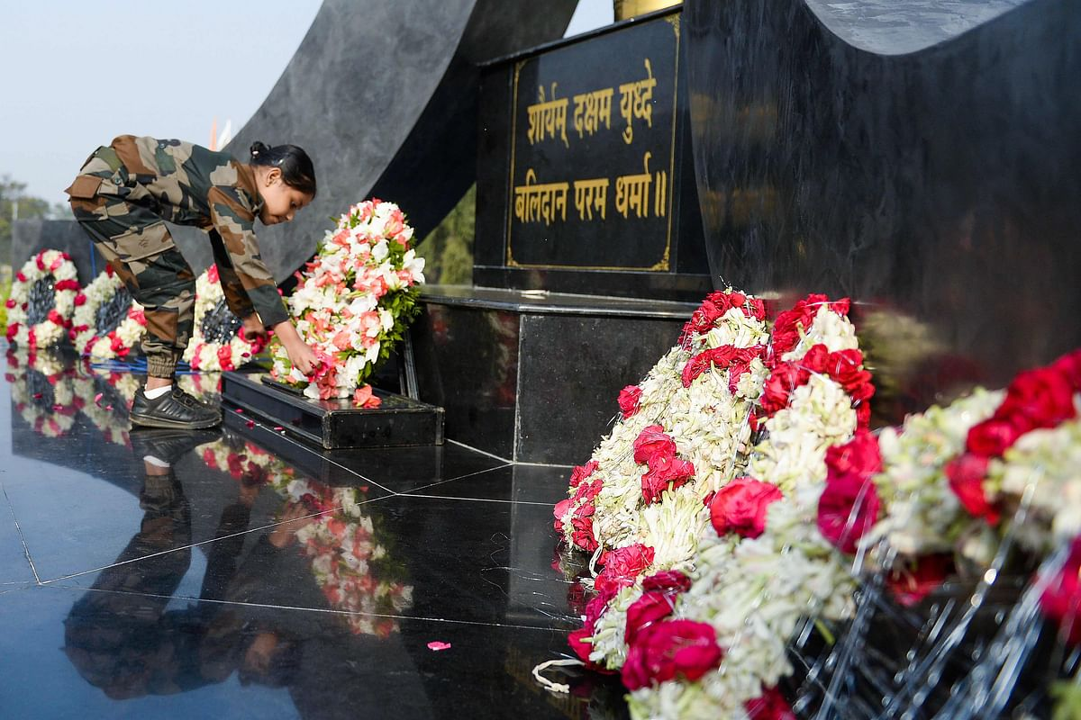 A girl wearing an Army uniform pays her tribute at a martyrs memorial to mark Indias 73rd Army Day in Secunderabad, the twin city of Hyderabad, on January 15, 2021