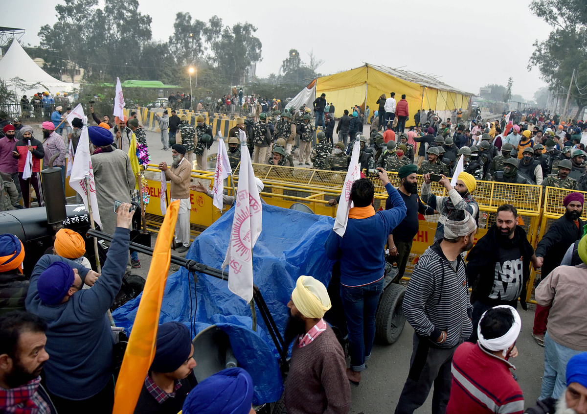 Tractor Parade: Farmers break police barricades, face tear gas shells to enter Delhi
