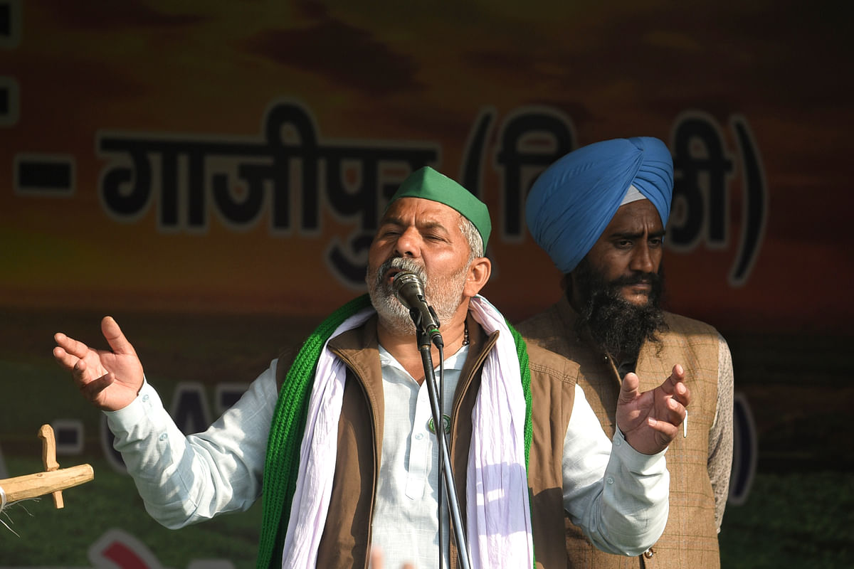 New Delhi, Jan 28 (ANI): Farmers leader Rakesh Tikait addresses during a protest against new farm laws, at Delhi-Ghazipur Border in New Delhi on Thursday.