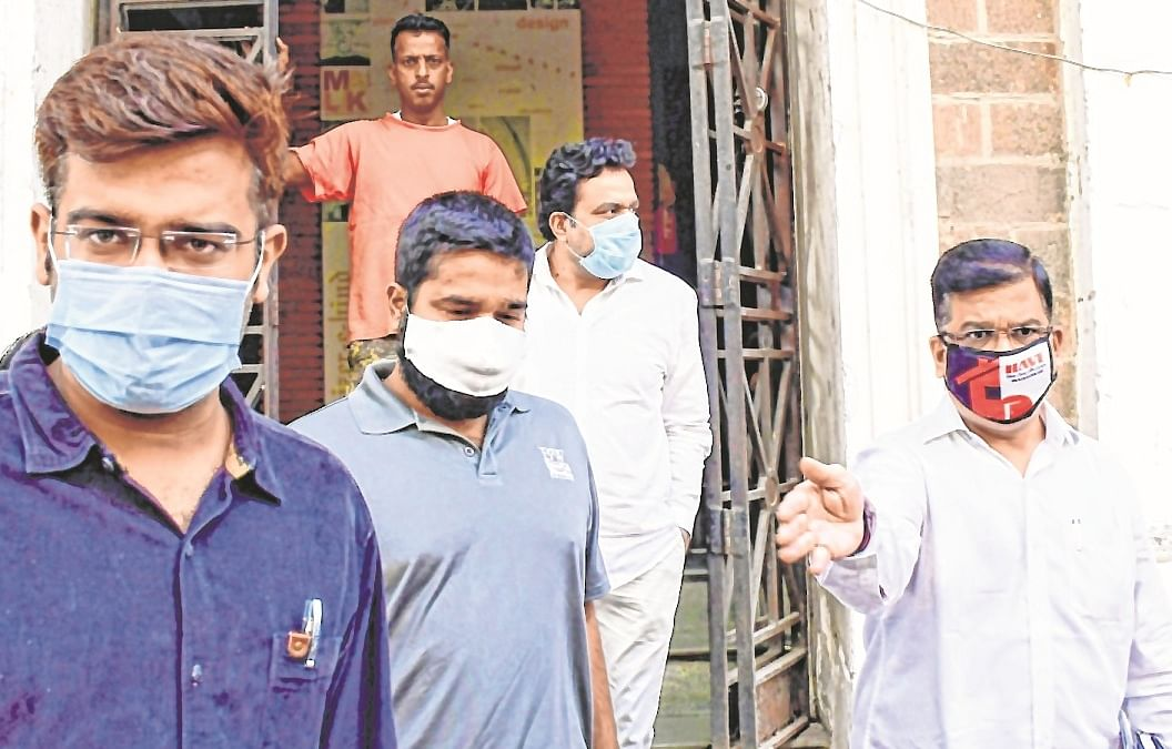 ED arrests Viva Group MD Mehul Thakur (grey T-shirt) & Director Madan Gopal Chaturvedi (white shirt with blue mask).