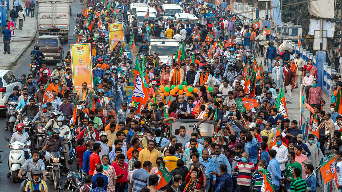 BJP leader Sovan Chatterjee and his close associate Professor Baisakhi Bandopadhay participate in a party rally ahead of West Bengal assembly elections, in Kolkata, Monday, Jan. 11, 2021