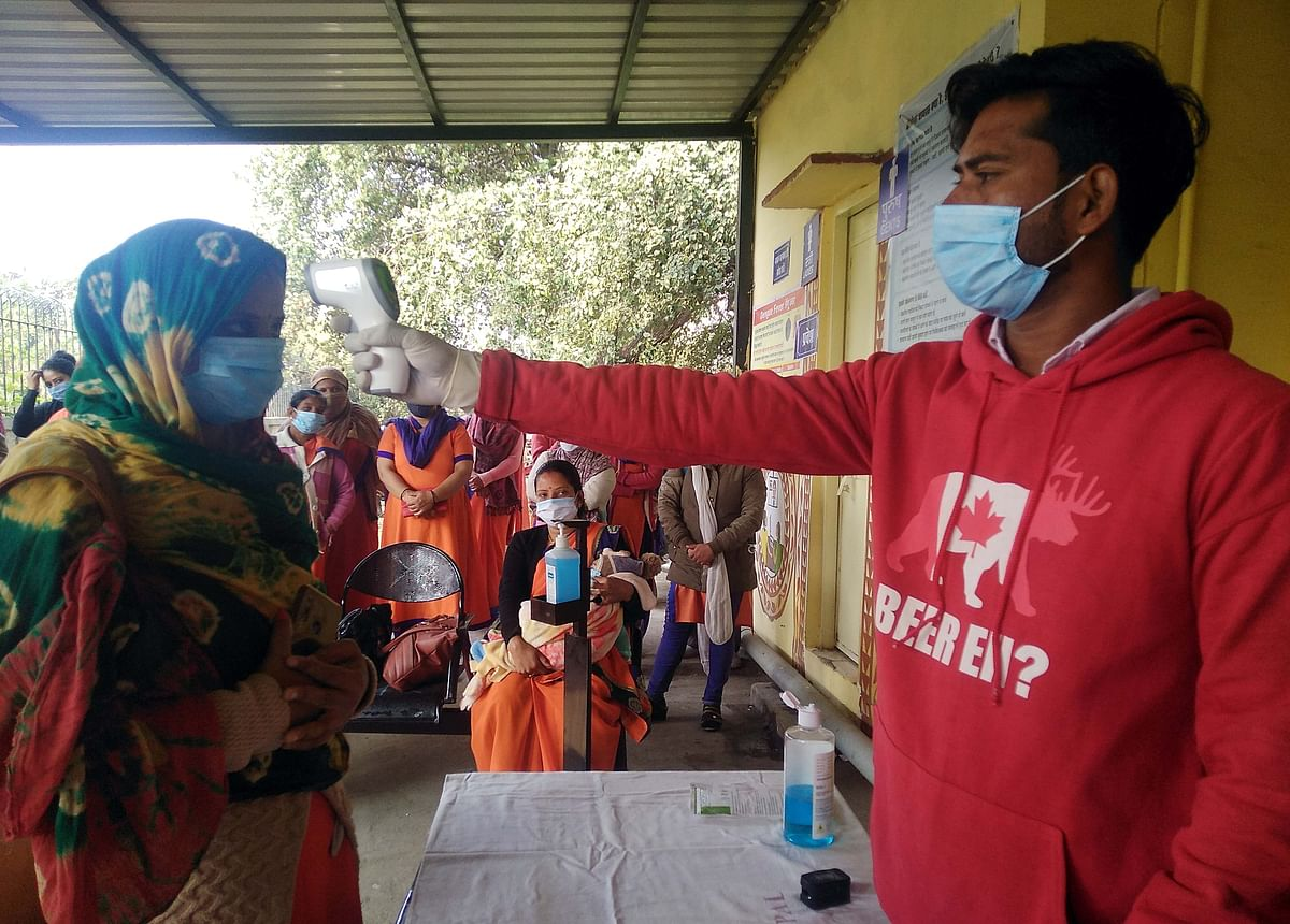 Select beneficiaries being subjected to thermal screening before vaccination during the dry run at the Govindpura vaccination centre in Bhopal on Saturday.