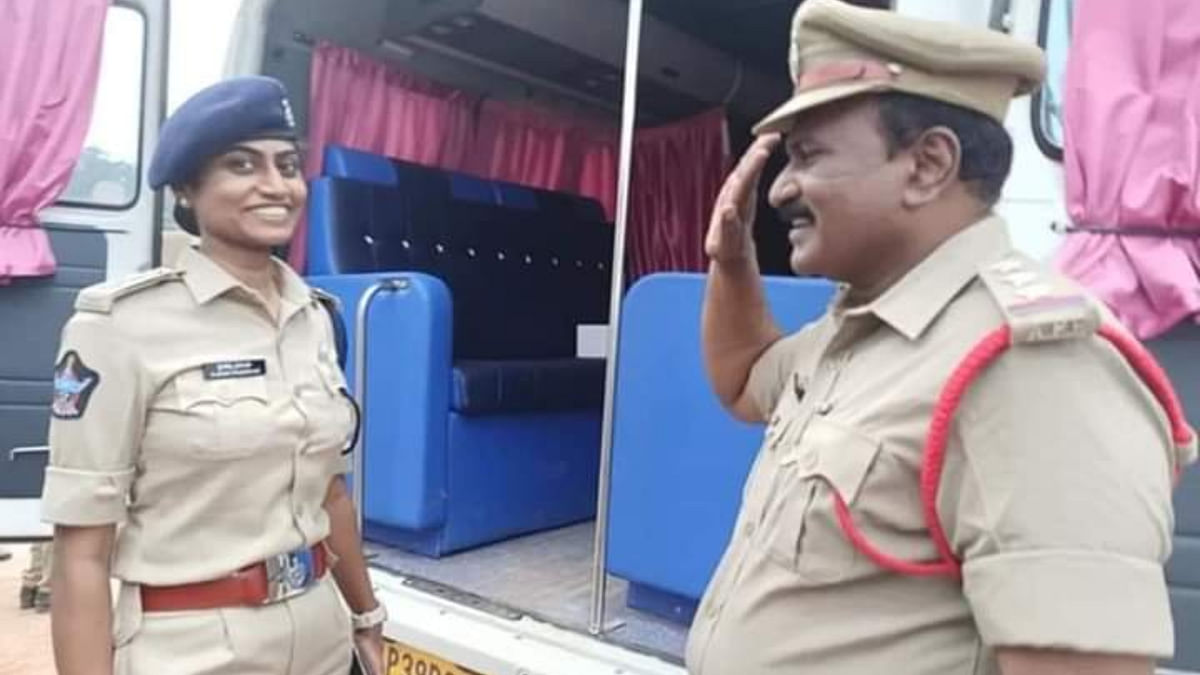 Circle Inspector Shyam Sundar salutes his own daughter Jessi Prasanti who is a Deputy Superintendent of Police
