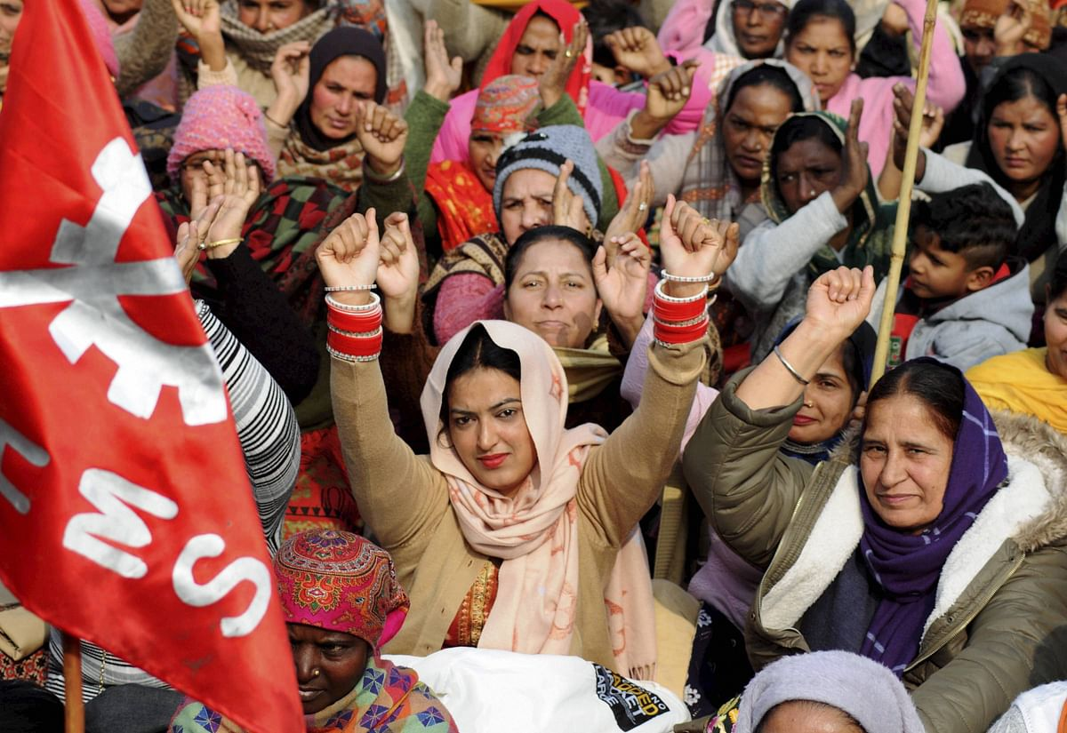 Activists of various organizations stage a demonstration to support farmers continuing their protest against the central government's recent agricultural reforms in Amritsar on Monday.