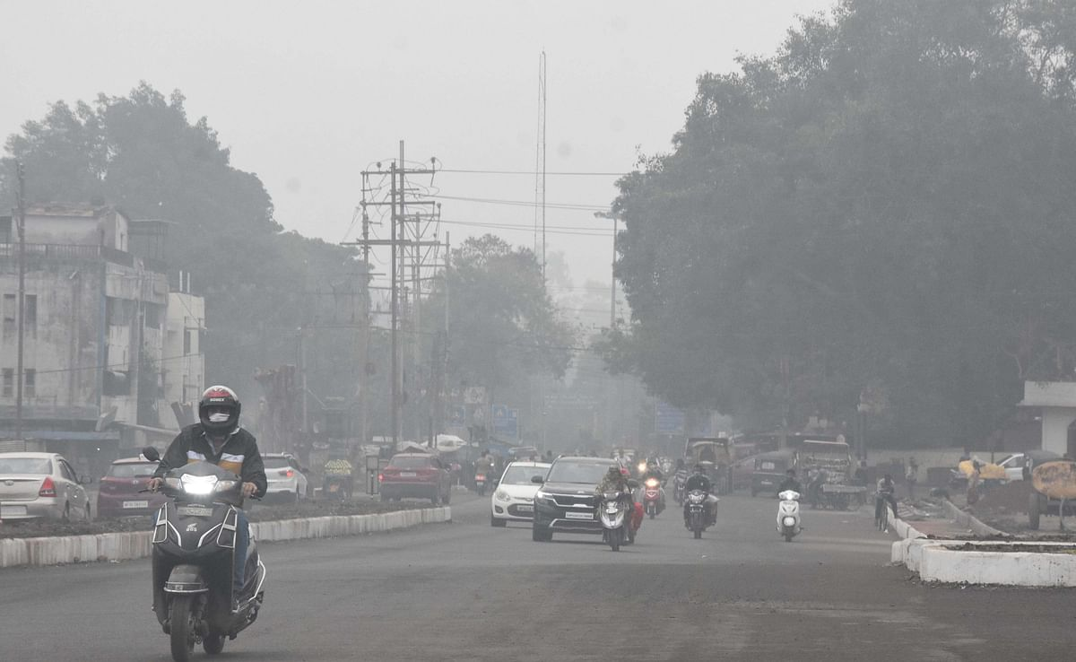 Fog envelops the state capital, Bhopal, on Monday morning.