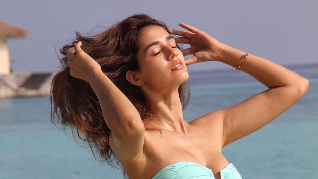 Disha Patani shares sizzling throwback pic wearing a strapless aqua bikini
