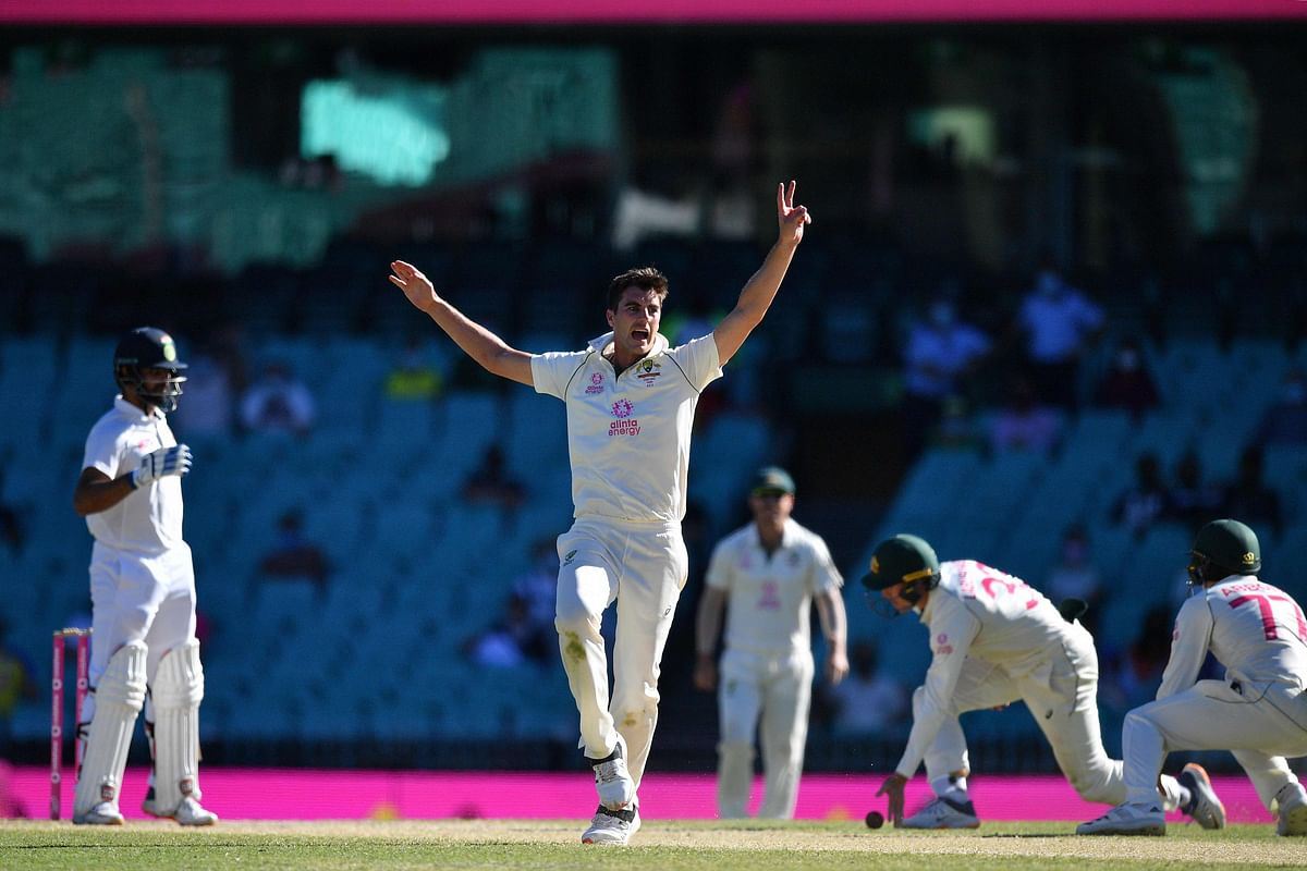 Pat Cummins (C) shouts an unsuccessful appeal against Hanuma Vihari during the fifth day of the third cricket Test match between Australia and India at the Sydney Cricket Ground (SCG) in Sydney on January 11, 2021.