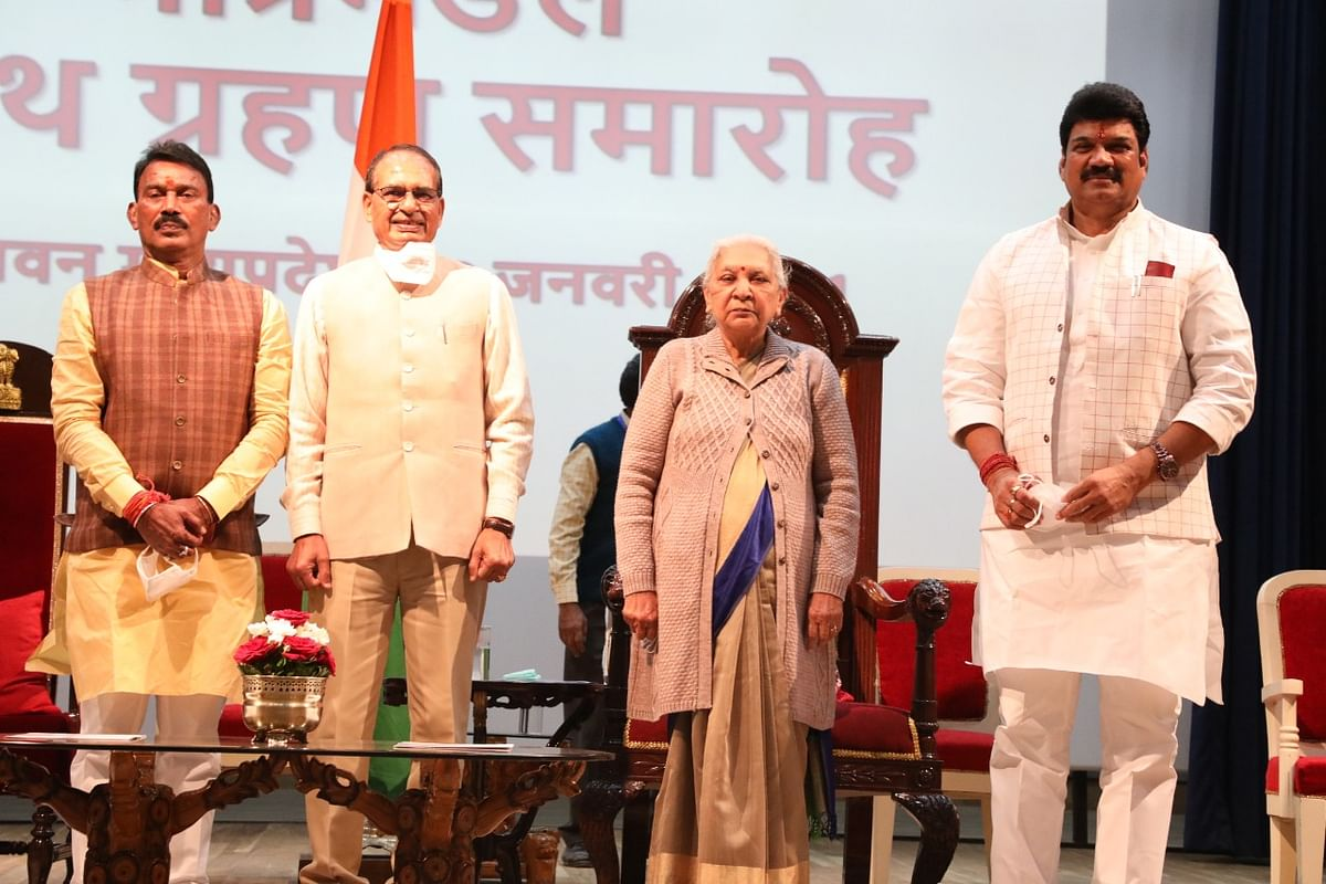 Ministers Tulsi Silawat, Govind Singh with CM Shivraj Singh Chouhan and Governor Anandiben Patel in Bhopal on Sunday