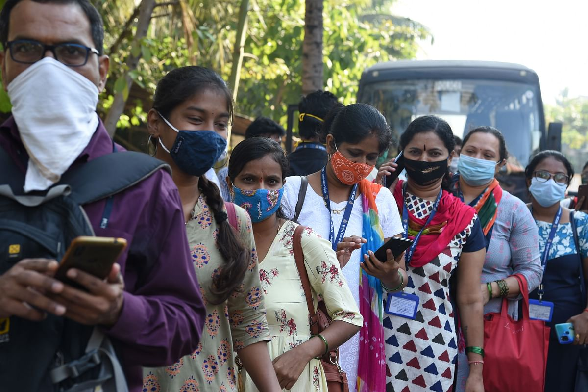 Health workers queue to receive a dose of a Covid-19 coronavirus vaccine at the Cooper hospital in Mumbai