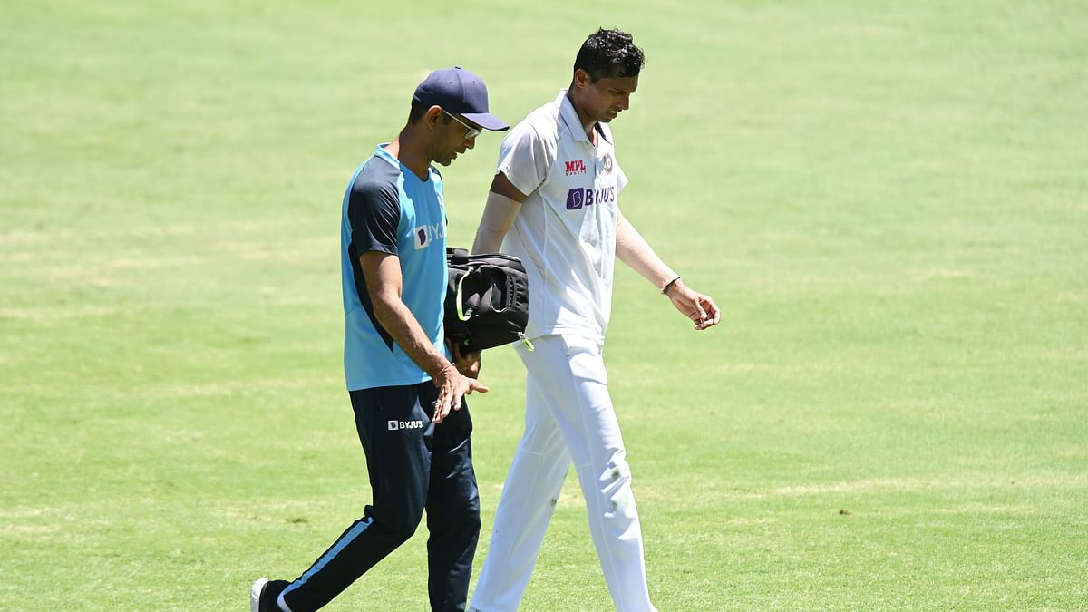 Navdeep Saini walking off the field after complaining of groin pain