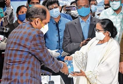 West Bengal CM Mamata Banerjee queues up for health card