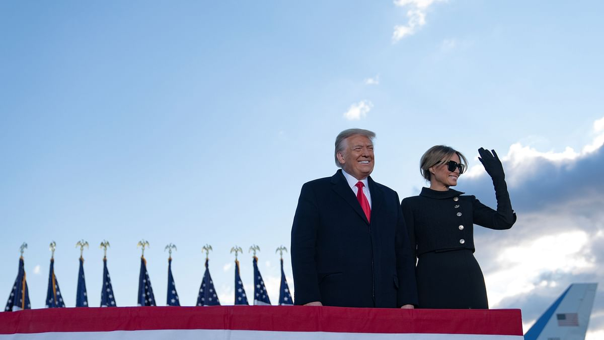 Outgoing US President Donald Trump and First Lady Melania Trump address guests at Joint Base Andrews in Maryland on January 20, 2021.