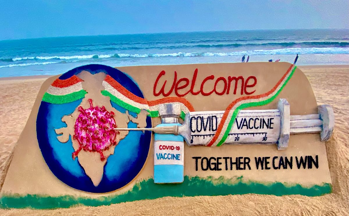 'Together we can': As COVID-19 vaccination drive begins in India, sand artist Sudarsan Pattnaik etches out message of hope