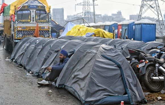 Camps set up in a row for farmers during an ongoing protest against farm laws at the Delhi-Ghazipur border in New Delhi on Monday.