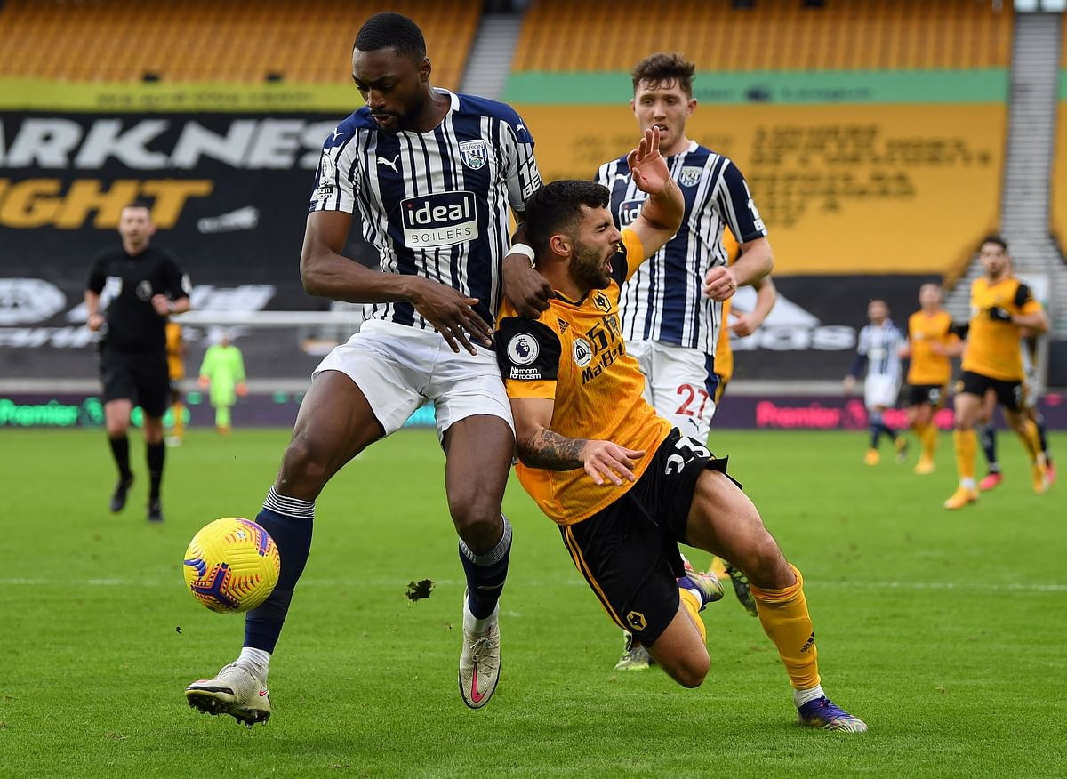 West Bromwich Albion's Nigerian defender Semi Ajayi (L) and Wolverhampton Wanderers' Italian striker Patrick Cutrone clash during their match at the Molineux Stadium in Wolverhampton, central England on Saturday