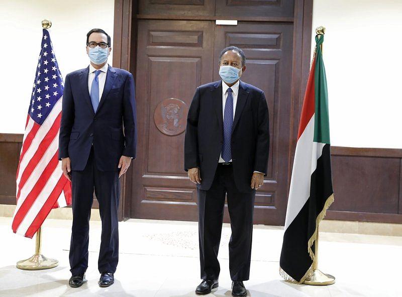 Sudanese Prime Minister Abdullah Hamdok, right, welcomes US Treasury Secretary Steven Mnuchin to the Cabinet Building, in Khartoum, Sudan, Wednesday, Jan. 6, 2021.