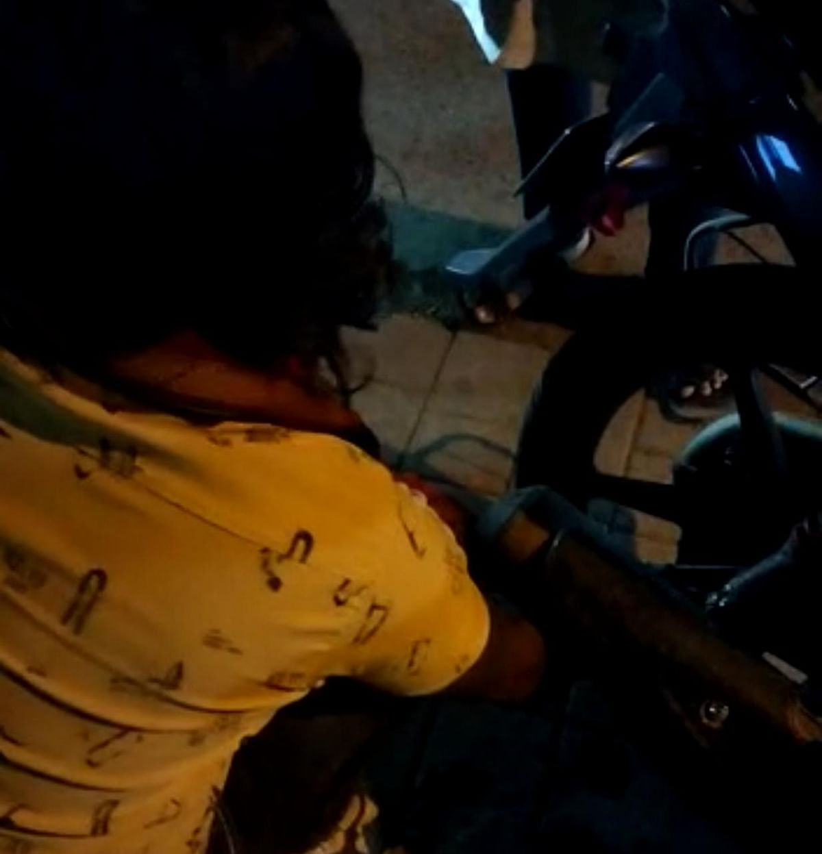 An autorickshaw driver deflating tyre of bike taxi in Indore on early Monday morning