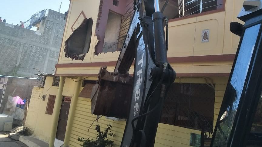 Illegally constructed house of history-sheeter Pradeep Pandey being razed in Bhopal on Wednesday