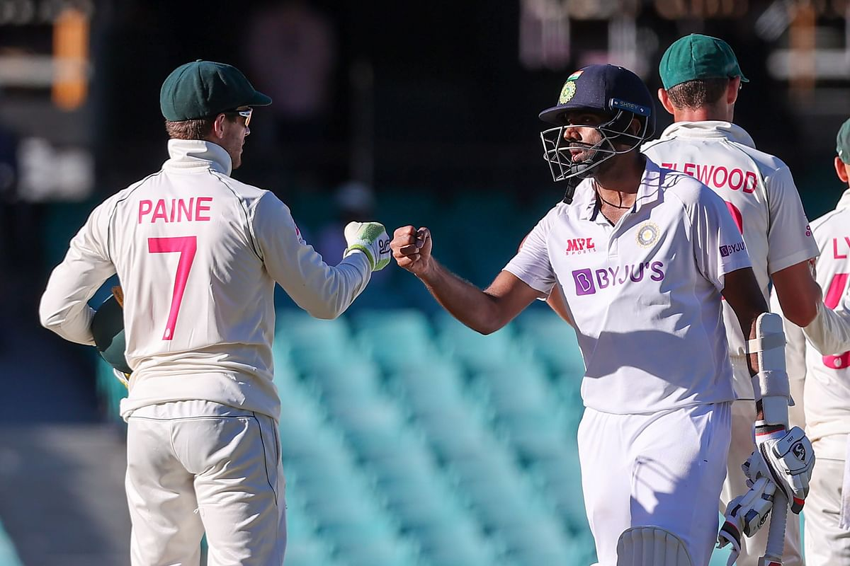 Ravichandran Ashwin fist-bumping with Australia captain Tim Paine at the end of the third cricket Test match between Australia and India at the Sydney Cricket Ground (SCG)