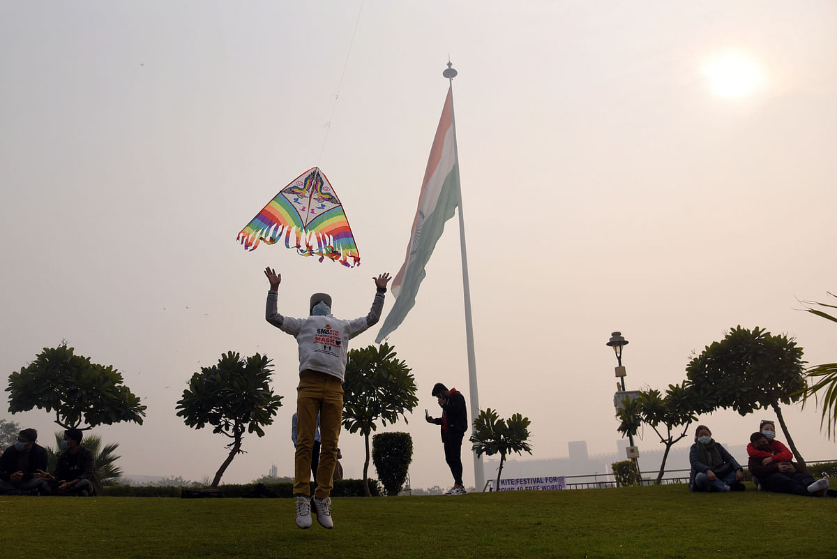 People flying kites on the occasion of Makar Sankranti, in New Delhi on Thursday.