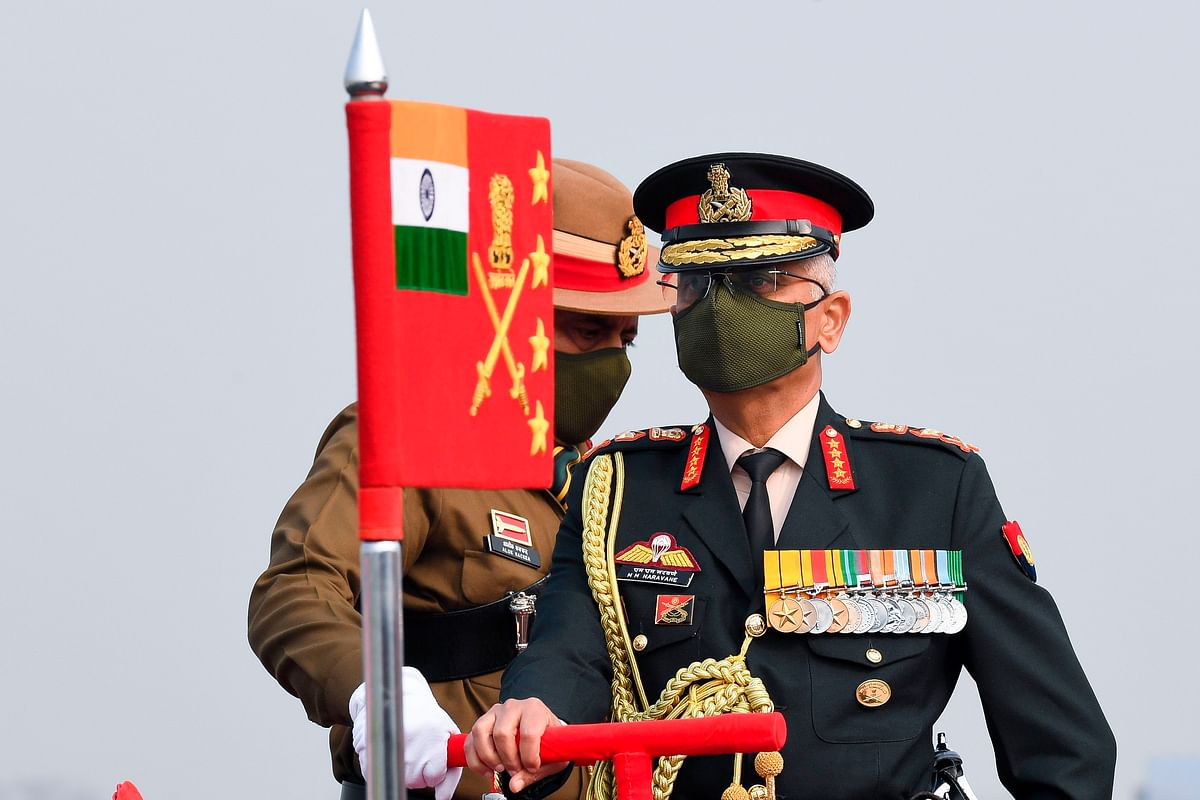 Chief of Army Staff General Manoj Mukund Naravane reviews a parade during a ceremony to celebrate Indias 73rd Army Day in New Delhi on January 15, 2021. (Photo by Prakash SINGH / AFP)