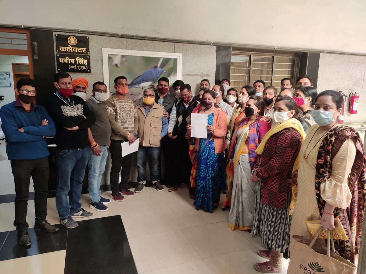 Parents reached collectorate demanding administration to intervene and help them by setting a proper fee for online classes on Tuesday