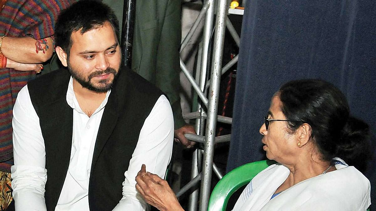 RJD's Tejashwi Yadav with West Bengal Chief Minister and TMC supremo Mamata Banerjee