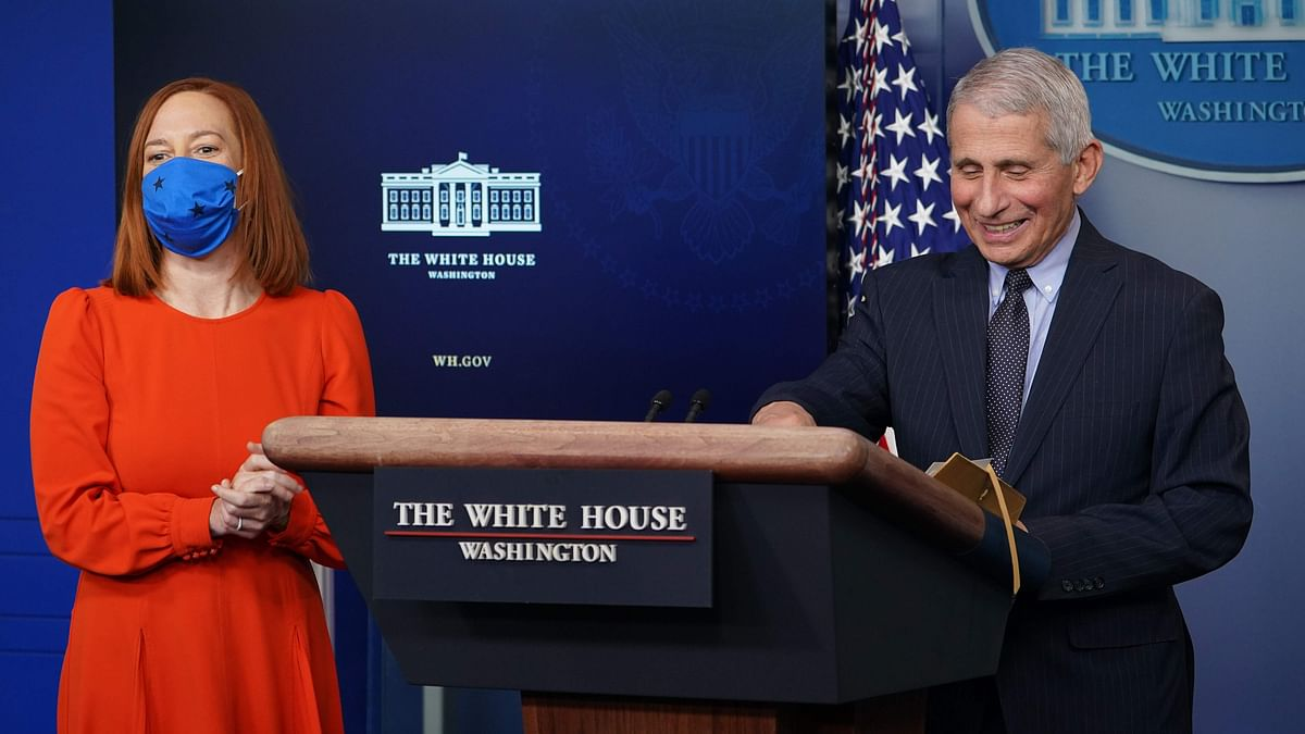 Dr. Anthony Fauci smiles as White House Press Secretary Jen Psaki (L) speaks to reporters during the daily briefing in White House on January 21, 2021