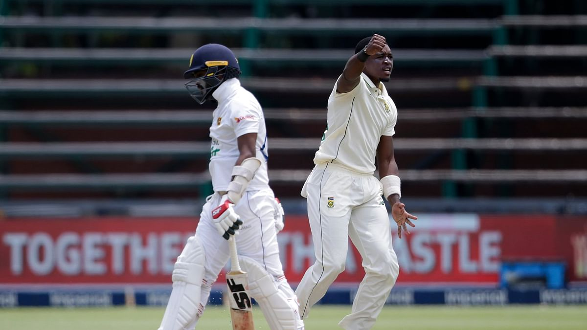 Lutho Sipaala (R) celebrates after taking a wicket