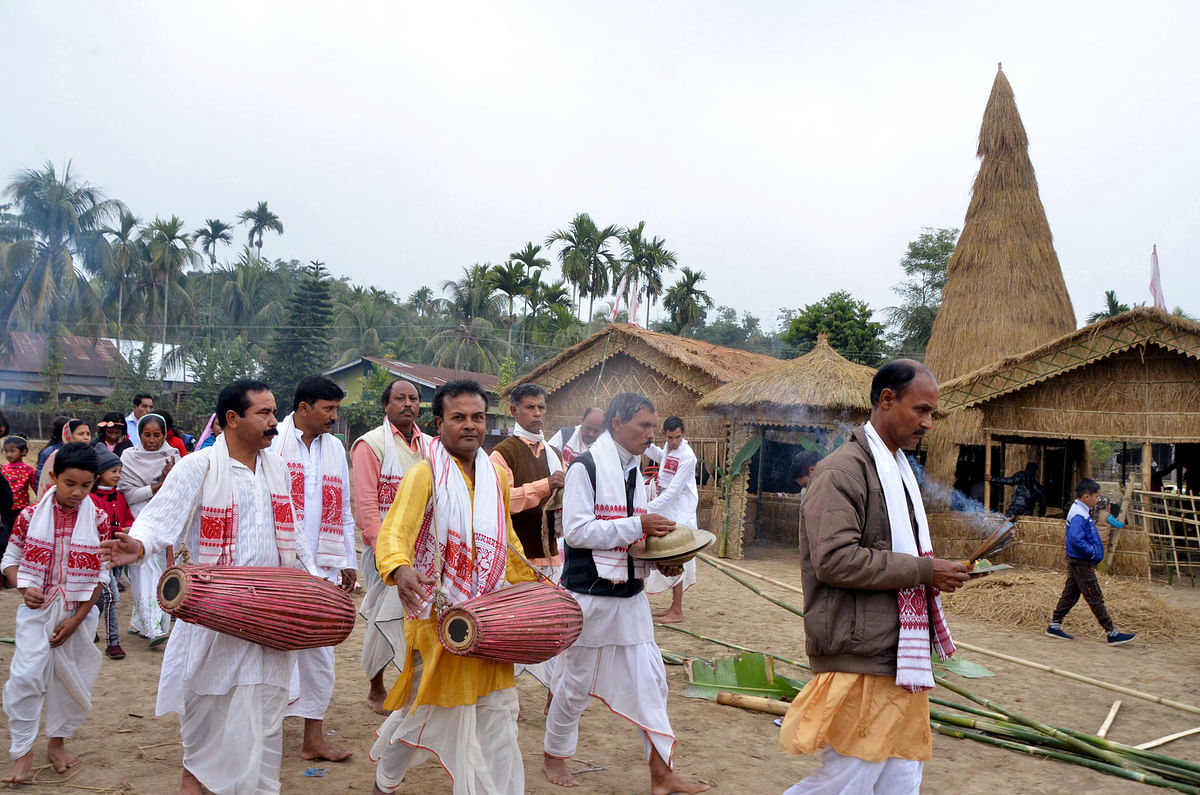 Villagers perform traditional ritual before the burning of the traditional Velaghor (Meji) on the occasion of Bhogali Bihu & Makar Sankranti in Tezpur on Thursday.