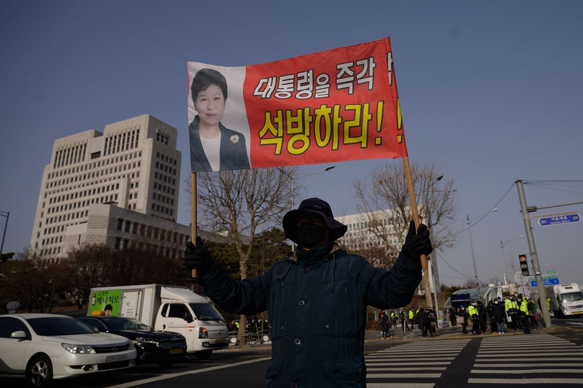 A supporter of former South Korean president Park Geun-hye stands outside the supreme court in Seoul on January 14, 2021, as the country's top court upheld a 20-year prison sentence.