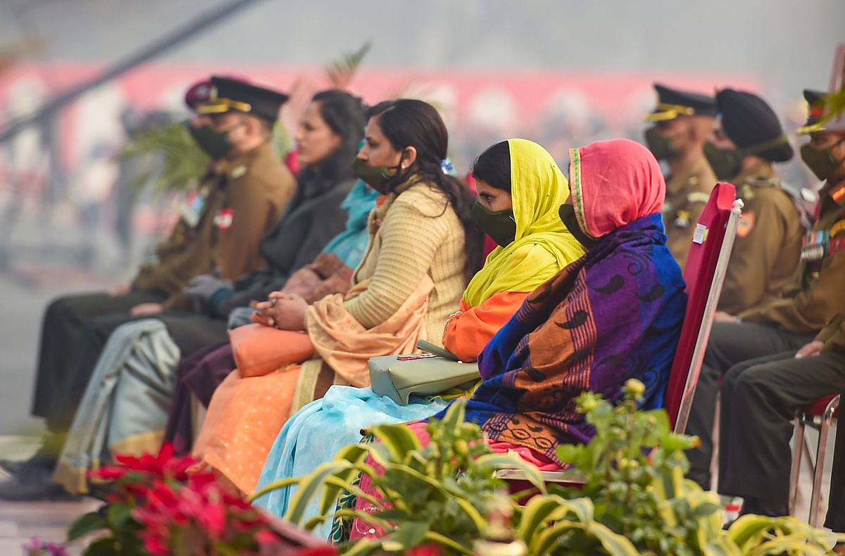 Widows of martyrs wait for the award distribution during the 73rd Army Day Parade, at Parade Ground in New Delhi, Friday, Jan. 15, 2021.