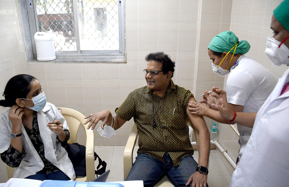 A healthcare worker gets a COVID-19 vaccine at Sion Hospital, in Mumbai on Saturday.