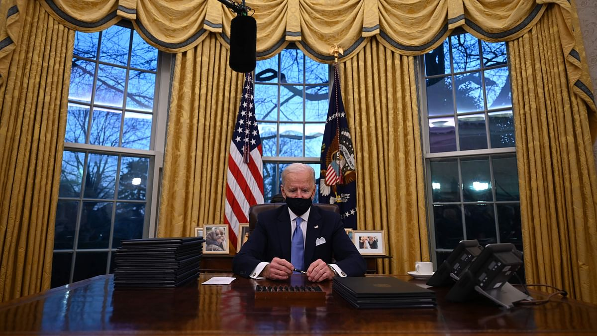 US President Joe Biden holds a pen as he prepares to sign a series of orders in the Oval Office of the White House in Washington, DC, after being sworn in at the US Capitol on January 20, 2021