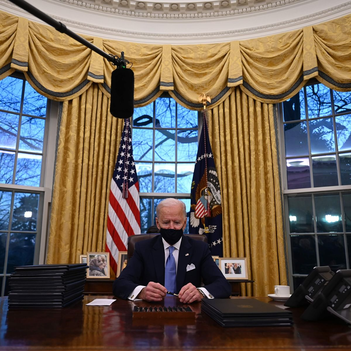 Hours after taking office, President Biden ends Trump's 'Muslim travel ban'