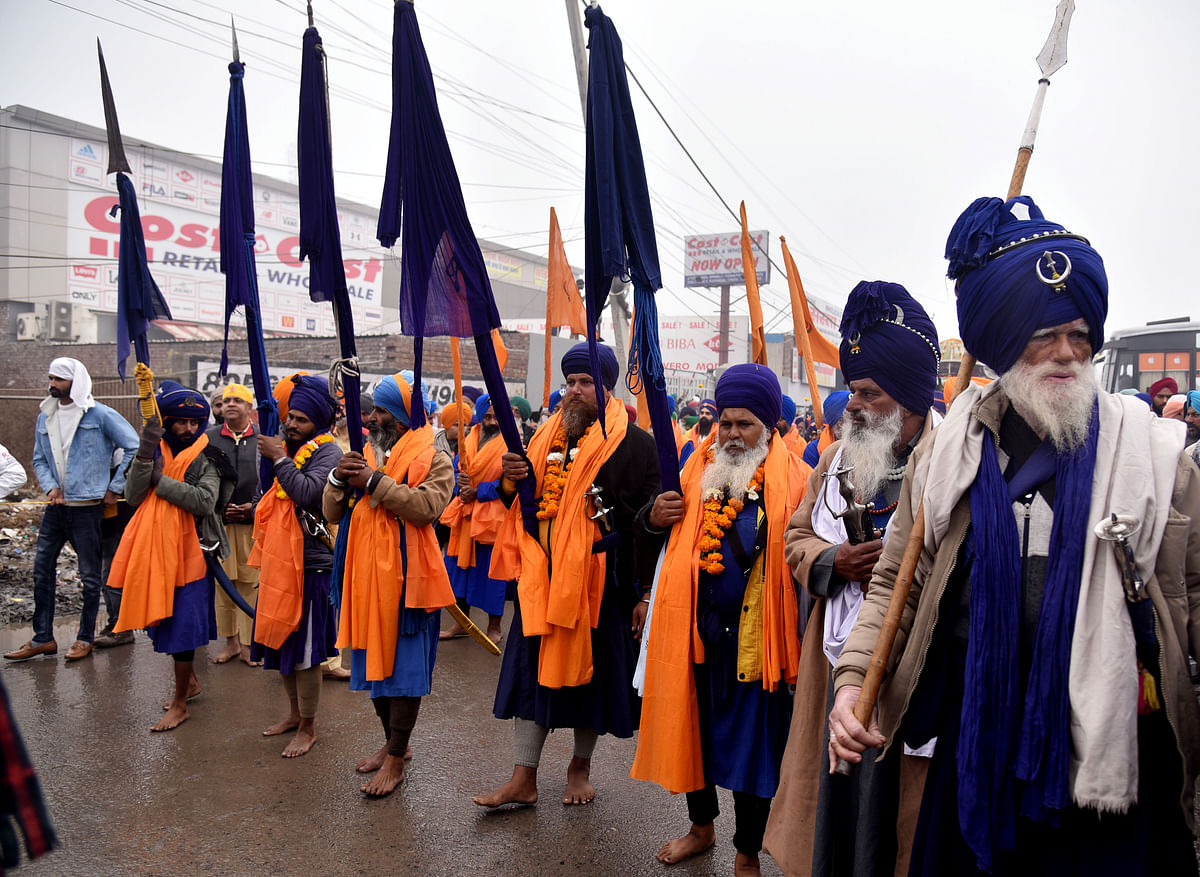 New Delhi, Jan 01 (ANI): Nihang Sikhs take part in a religious procession at Singhu border during farmers against Farm law, in New Delhi on Friday.