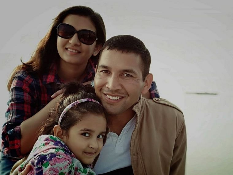 Bhavna Bisht with her husband and daughter, Nayesha