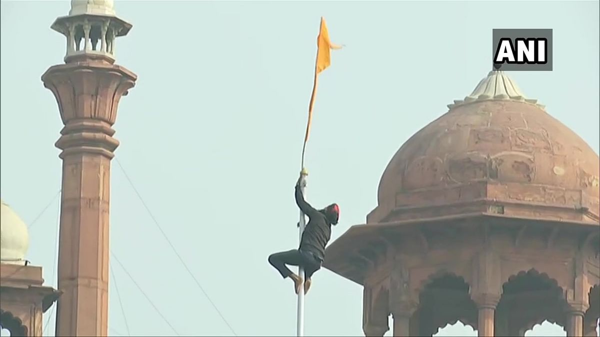 In Pics: Protesting farmers breach Red Fort, put up union flag, 'Nishan Sahib' at lower rampant