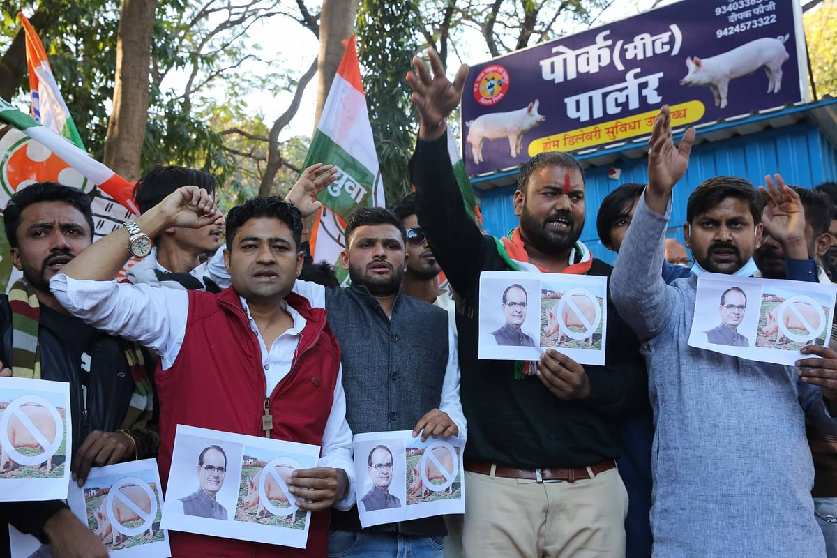 Youth Congress activists stage protest at pork outlet of MP Livestock Corporation in Bhopal on Wednesday.
