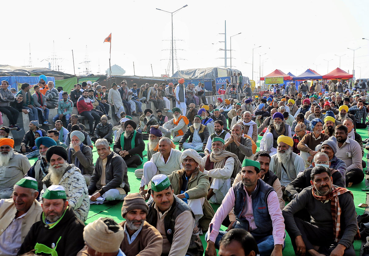 New Delhi, Jan 21 (ANI): Farmers sitting at Ghazipur border during their protest against farm law, in New Delhi on Thursday.
