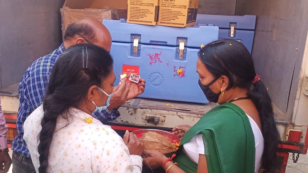 File Photo/ Neelima Dongre, a nurse who lost her 24-year-old son Rishabh due to corona performed arti of box containing a total of 440 vaccine in Kukshi village of Dhar district on Sunday, a day head vaccination to begin in Kukshi tehsil