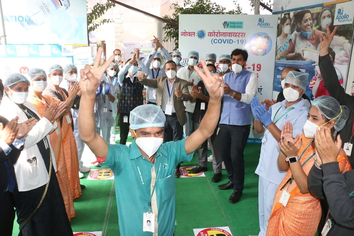 Apollo Hospital staffer Sunny Sunhare was welcomed by hospital staff after he received first vaccine