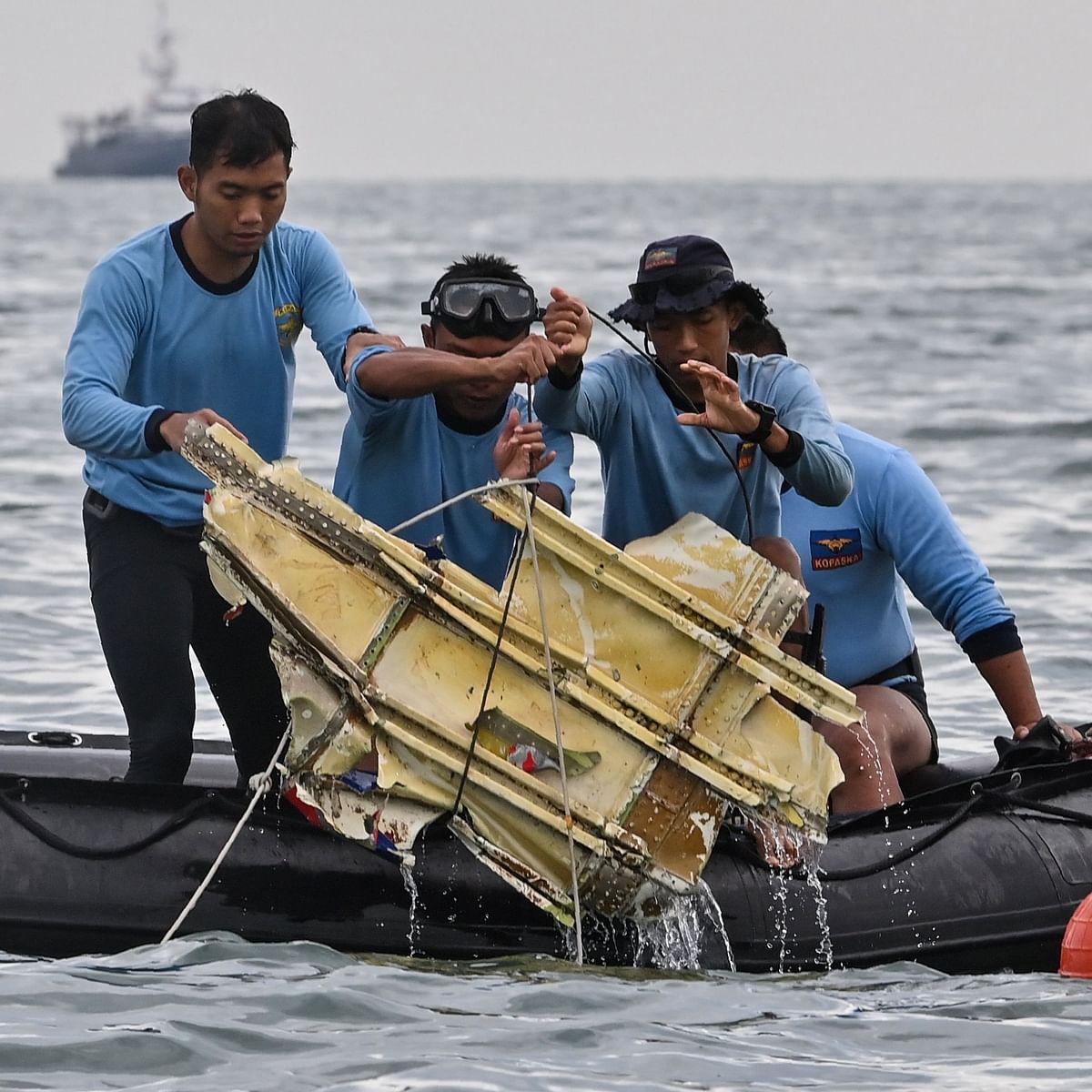 Body parts, debris found at Indonesia plane crash site